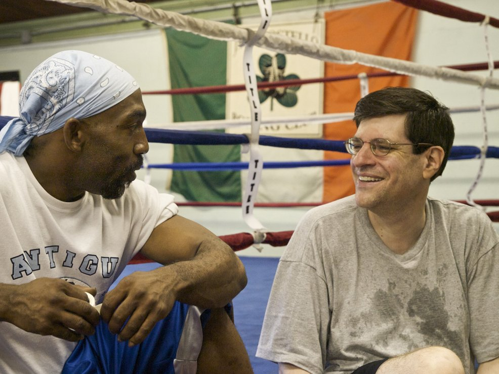 After his first lesson, Buddy and boxing coach Mr. T hang out.