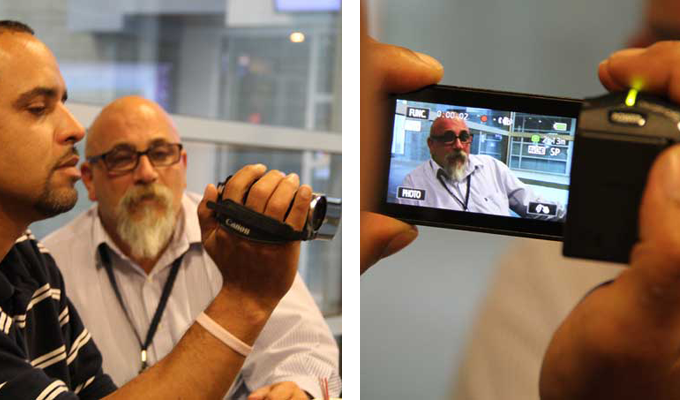 Angelo Colon tries out camera on his subject, colleague and friend John Rocco